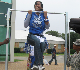 Hampton University student motivated to exercise on the pull bar for homecoming weekend.