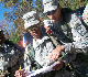 Cadet Flood providing guidance to Cadet Martin during land navigation training